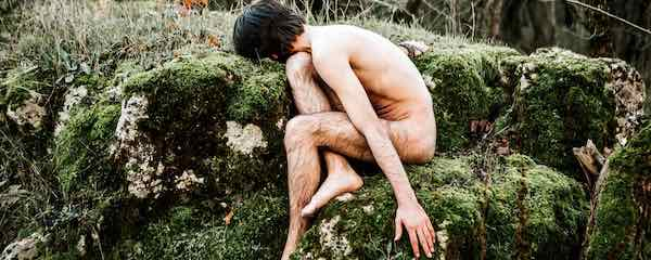 Naked foetal man in Nature